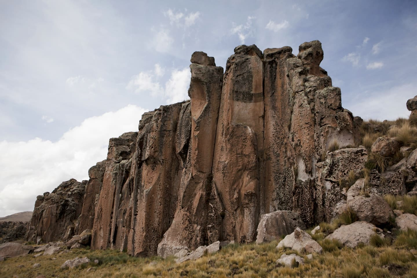 Large rock formations by erosion of wind, rainwater and ice located in Callalli zone in the route Chivay to Cusco - Peru with Bus 4M Express